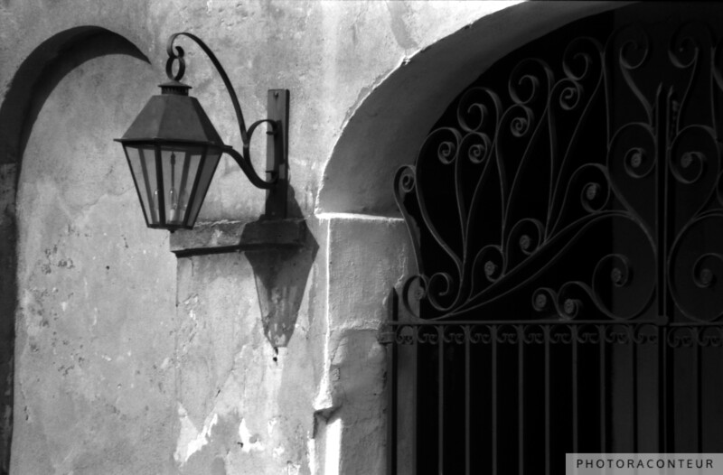 """State Street Gate"" ~ B&W composition of wrought iron gate and lantern at historic home in Charleston, SC."