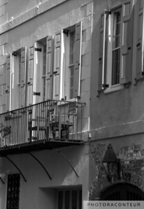"""Queen Street Balcony"" ~ B&W composition of wrought iron balcony along a row of townhomes in historic Charleston, SC."