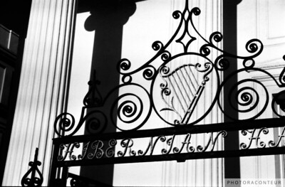 """Hibernian Iron & Columns No. 1"" ~ B&W composition of columns and wrought iron at the Hibernian Hall in historic Charleston, SC."