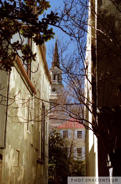 """Charleston Alley View"" ~ View down an alley of St. Philips church and colonial homes in historic Charleston, SC."