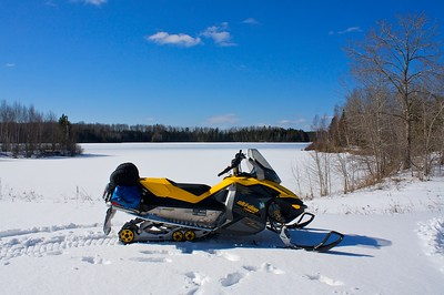 All my camping gear is strapped onto the back of the sled. I can go anywhere in the forest. I had this lake all to my self. This shot was taken by the Dam at Day Lake near Clam Lake WI.