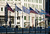 Tuesday, 28 October 2008- The United States, Illinois, Chicago, and Chicago 2016 flags fly over the Michigan Avenue bridge, backlit by the Wrigley Building.