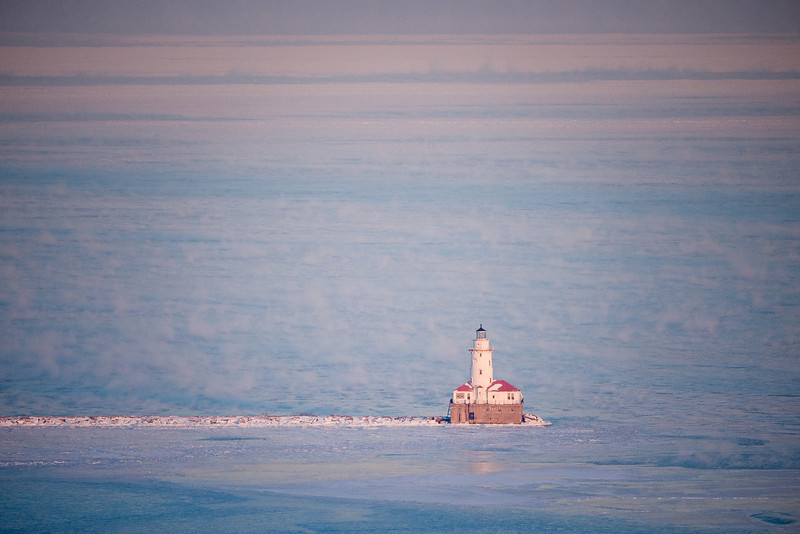 Thursday, 15 January 2009- The Chicago Harbor Lighthouse and a steamy, frozen Lake Michigan.