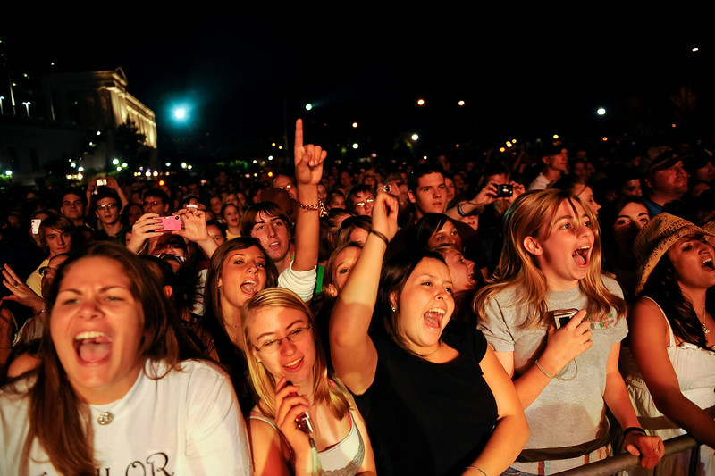 Sunday, 12 October 2008-  Fans cheer on Taylor Swift during her performance at the Chicago Country Music Festival.