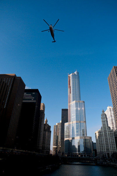 Saturday, 03 January 2009-  A helicopter cruises over the Chicago River after installing the first of eight pieces of the spire atop Trump International Hotel and Tower.