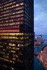 18 August 2009-  The IBM Building, Mies Van Der Rohe's last skyscraper, reflects the setting sun as the Chicago River winds toward Lake Michigan.