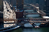 25 February 2010- Wacker Drive shines in the mid-day sun as river barges navigate under Chicago's bascule bridges.