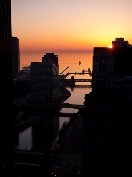 Saturday, 14 March 2009-  The equinox cometh as the sun nearly rises north of due east.  Soon the joy of north light will cast itself on Chicago again.