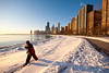 11 February 2010- A cross-country skier and the city skyline shortly after sunrise on a cold February morning.