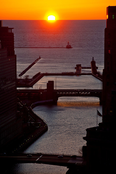 26 March 2010- The sun rises over Lake Michigan north of the source of the Chicago River indicating north light is back in the city. Who's excited, folks?!!