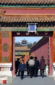Through the an inner gate -- You can see a small pagoda that sits on a small hill behind the Forbidden City