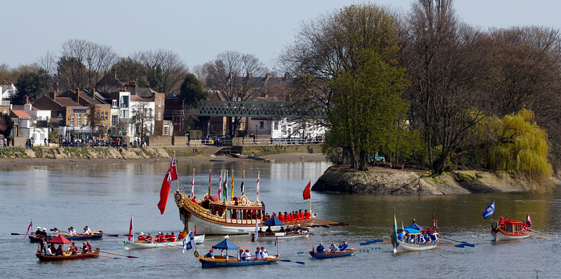 Two City Barges. The historic pub on the left and royal rowbarge Gloriana in the centre.