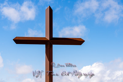 Holy Cross Against Cloudy Blue Sky