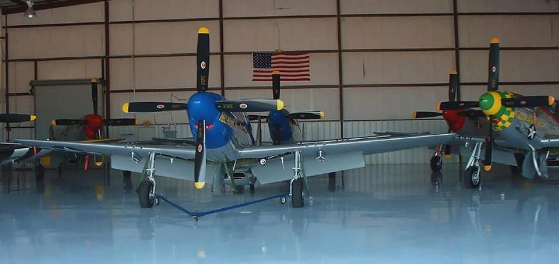 These incredibly restored P-51's were not the only Mustangs on site that day at Kissimmee Airport in 2004. No airshow or big event- just another day at Stallion 51's spotless hangar. Each one was restored as well as any show car.