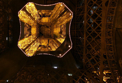 Straight up into the Eiffel Tower. Large catch nets used for the Tower restoration put a damper on many of my planned shots, including this one.