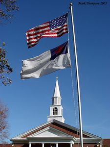 Flags in front of steeple