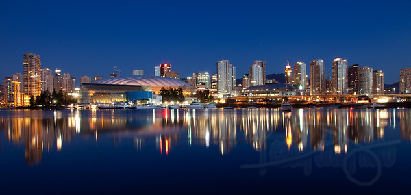 Vancouver skyline with BC Place Stadium and UBC Thunderbird Arena from False Creek.