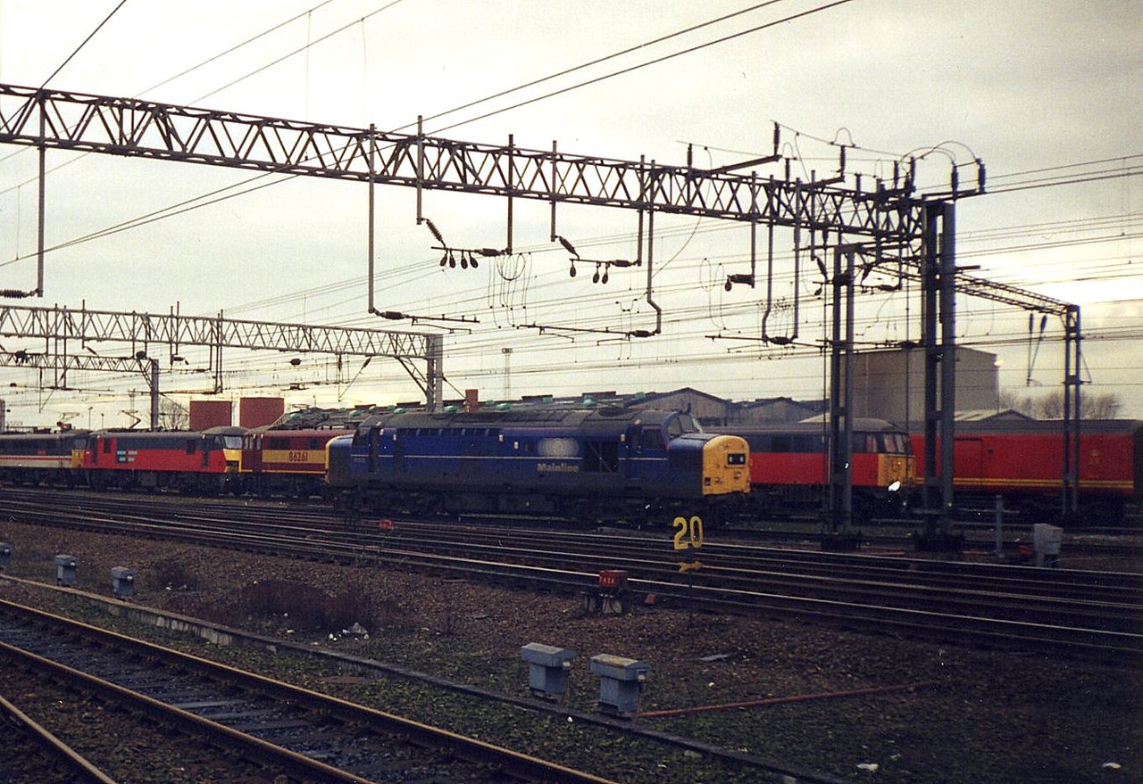 37372 departing Crewe Diesel Depot. December 1998.