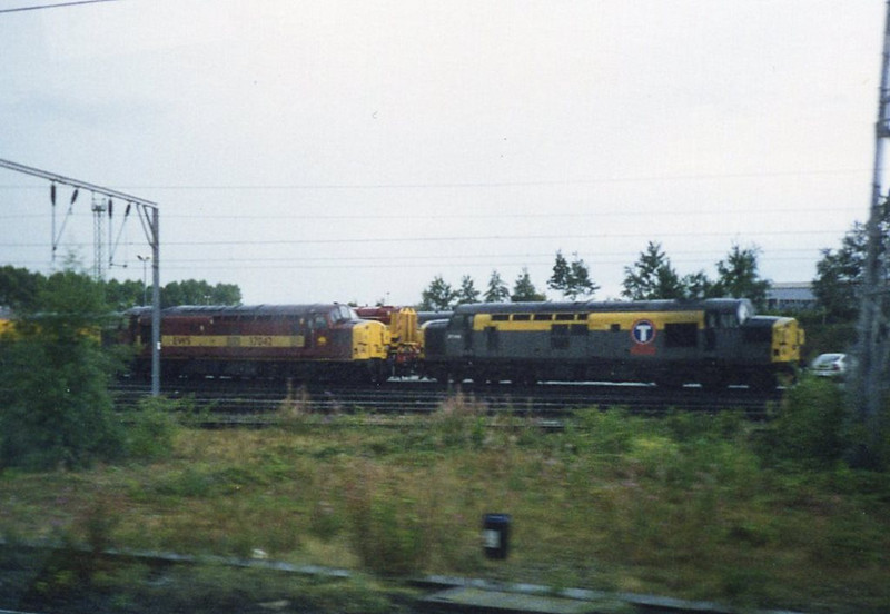 37043 and 37042, Crewe DMD. August 1999.