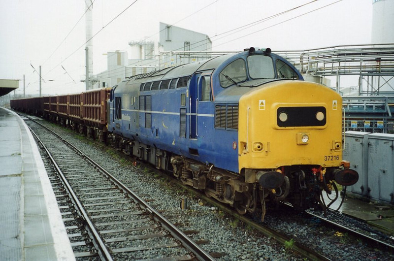 37216 at Warrington with a northbound scrap train. February 2002.
