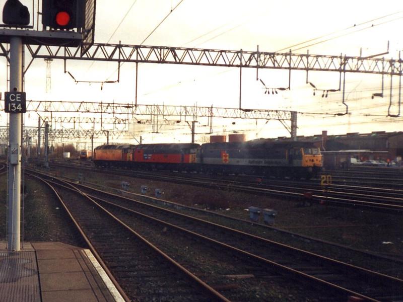 47375, 47726 and 47501. Crewe. February 1999.