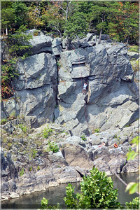 A group of people on the Virginia side doing a little rock climbing.  Not me!  I'd much rather go down than up! :)