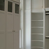 Painted master, curved corner shelving, hang behind doors