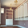 Basic wall hung white melamine closet, oval chrome poles