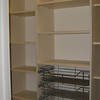 Pantry closet with baskets in antique white melamine