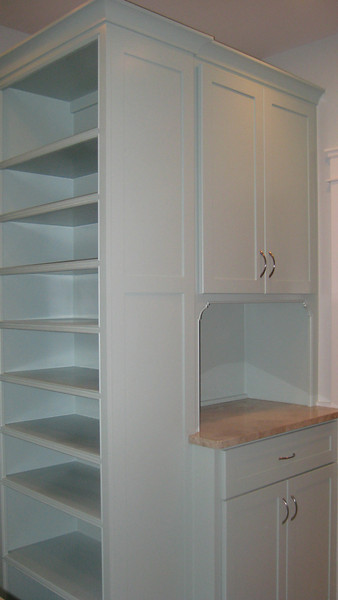 Painted Master closet, finished end panel on shoe shelves