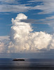 Cumulus cloud and container ship