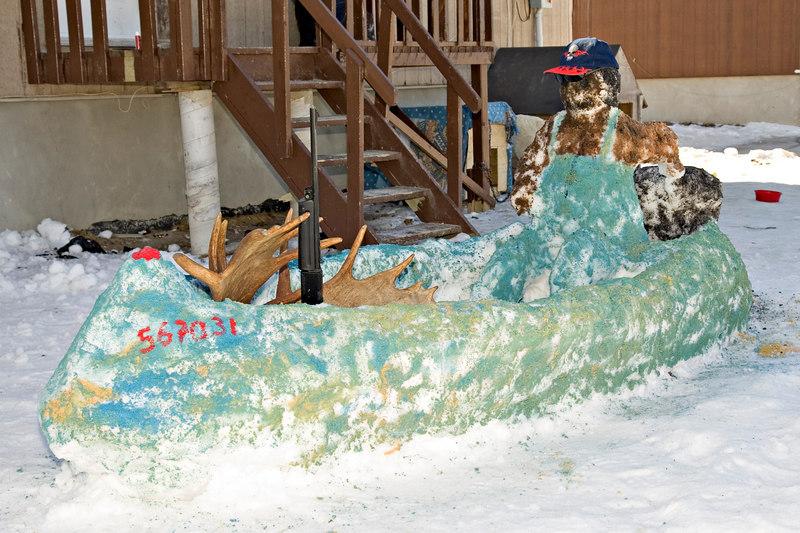 First prize winning snow sculpture of canoe by Wayne and Alexandra Iserhoff of Moosonee, Ontario.