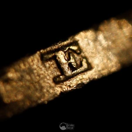 'E' Rim of the Napoleon III coin.