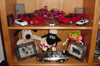 I have made space for my increasing collection of vehicles on the shelves of my home office.  The Back to the Future Delorean was an unexpected birthday gift from a coworker.