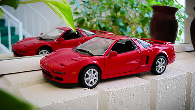 Unlike my original Revell model, this Kyosho one has 7 spoke rims and a color matched roof like my 1:1 NSX-T.  This newer model has a few additional working details like headlights that pop up and a trunk that opens.  If only I could find one at this scale with a removable roof panel.  Since the Revell model is at work, I will be displaying the Kyosho one upon our fireplace mantel.