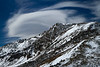 A cloud sculpted by wind over a mountain peak on Loveland Pass.<br /> Photo © Cindy Clark