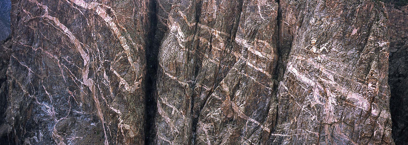 Pegmatite intrusions on Painted Wall at Black Canyon of the Gunnison.<br /> Photo © Carl Clark