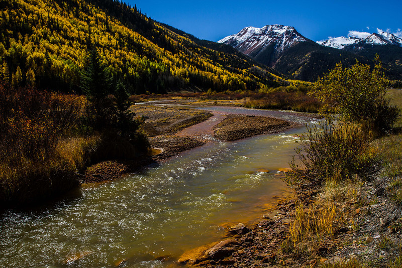 Red Mountain Creek flows from the peaks of Red Mountain Pass.<br /> Photo © Carl Clark