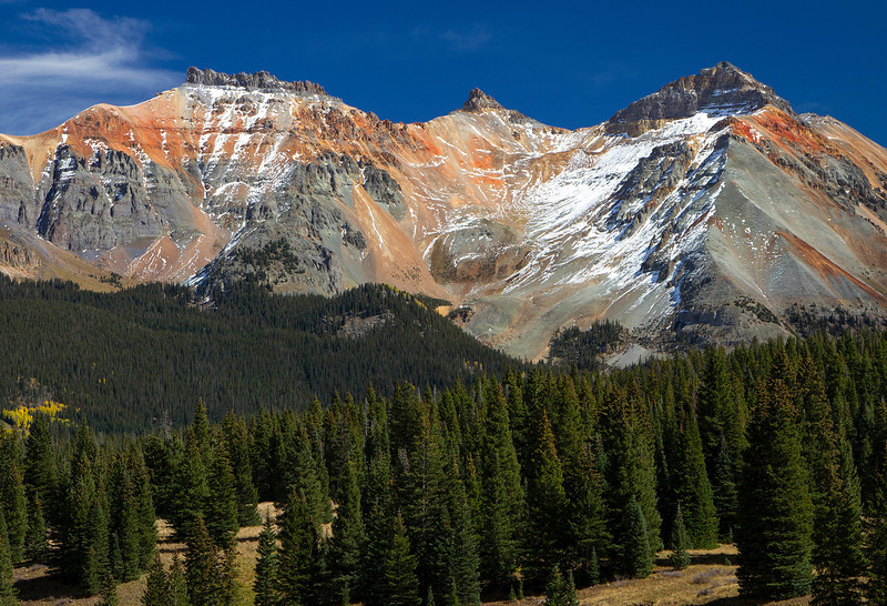 The oxidation of iron sulfide produces this color on mountains along Highway 145 heading south from Telluride.<br /> Photo © Cindy Clark