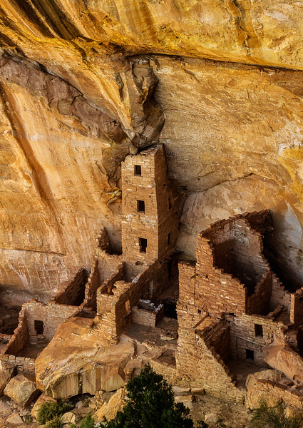 The cliffs of Mesa Verde provide a dramatic backdrop to the ruins.<br /> Photo © Cindy Clark