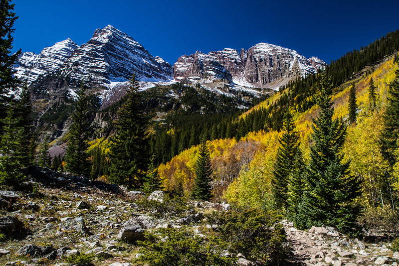 Autumn colors and snow on the Crater Lake trail at Maroon Bells.<br /> Photo © Carl Clark