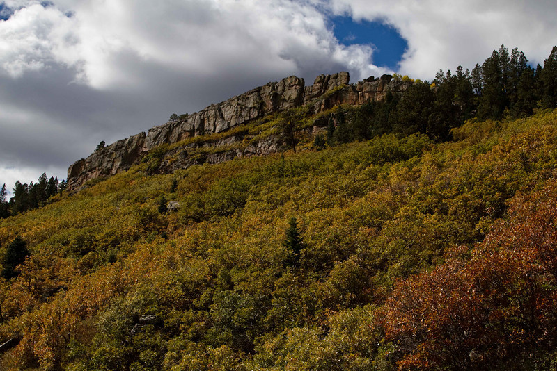 Foliage and cliffs near Monument Reservoir.<br /> Photo © Carl Clark