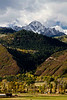 Soft autumn colors offset the early snow on Mt Sneffels.<br /> Photo © Carl Clark