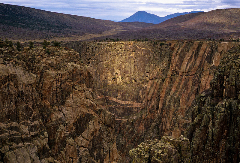 A sunray lights up Painted Wall in the Black Canyon of the Gunnison.<br /> Photo © Cindy Clark