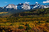 Thick autumn foliage below peaks in the Sneffels Range.<br /> Photo © Carl Clark