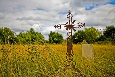 Iron cross in the cemetery at St Giles' Church, Mountnessing, Essex.