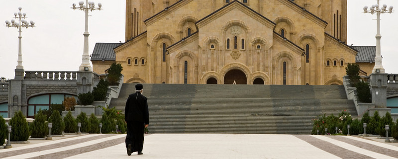 Cleric approaching Sameba Cathedral Tbilisi