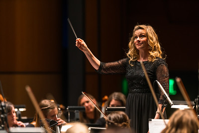 Dr. Joni Jensen conducts the choir and orchestra in the April 2019 Concert