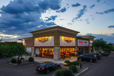 Firehouse Subs lighting accentuated under picturesque sunset clouds. Mesa, AZ 2017