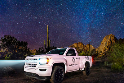 Black Hat Security Truck in the Arizona Desert with Saguaro Cactus and Stars
